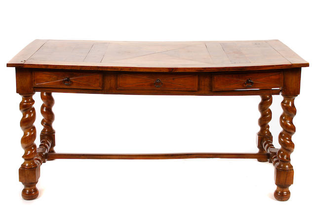 A Baroque style mixed wood library table
