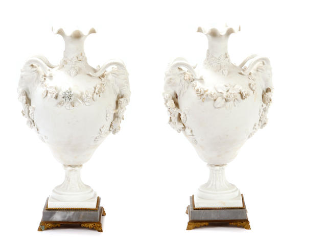 A pair of Neoclassical style bisque porcelain vases