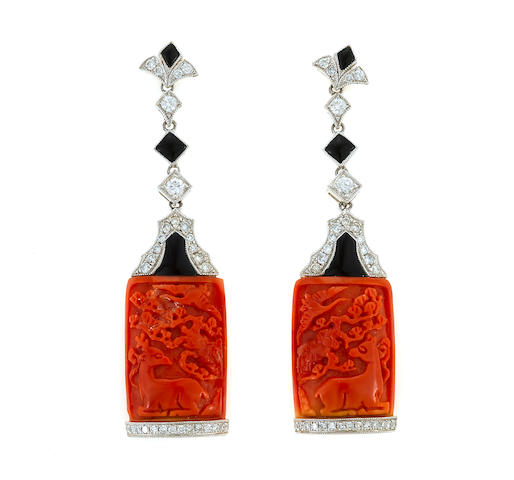A pair of carved coral, onyx, and diamond earrings in 18k white gold, 11.8g