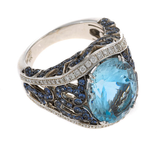 An aquamarine, diamond, sapphire and 18k white gold, Garrard