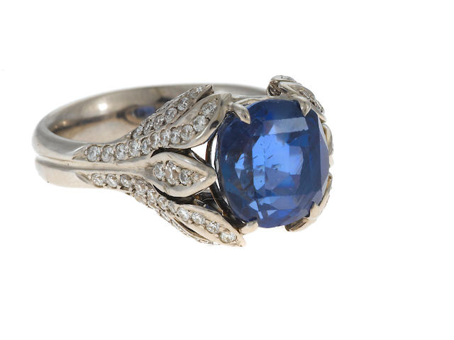 A 5.29cts. no heat sapphire, diamond and 18k white gold ring; accomanied with a cert **cert to come**