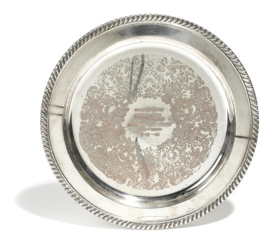"A silver plate ""Woman of the Day"" award presented to Marion Davies"