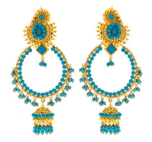A pair of turquoise and high karat gold earrings