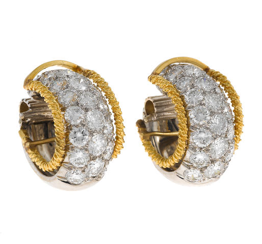 A pair of diamond and platinum earclips together with a pair of gold wire jacket earrings; 48 diamonds etdw: 4.90cts. from past appriasal