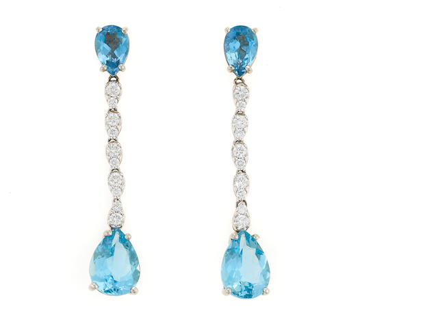 A pair of aquamarine, diamond, and 18k white gold earrings, aq=8.47cts
