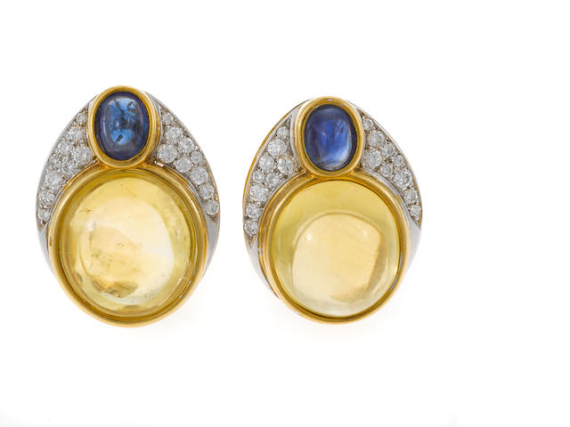 A pair of yellow/blue sapphire, diamond, and gold earrings
