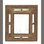 A Flemish Baroque brass repoussé decorated and ebonized wall mirror