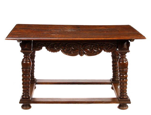 A Continental Baroque style oak table