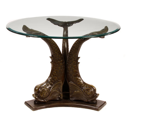A Neoclassical style bronze and glass center table