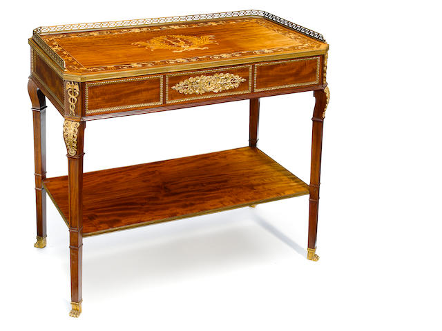 A Louis XVI stylegilt bronze mounted marquetry inlaid mahogany side table <BR />Collinson and Lock<BR />late 19th century