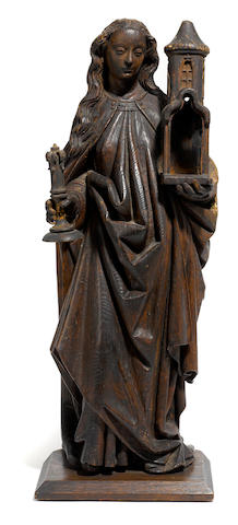 A Continental carved figure of Saint Barbara