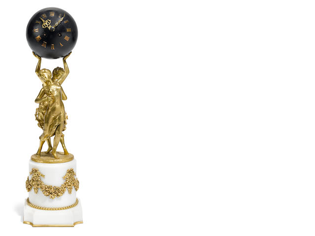 A French gilt bronze and marble mantel clock <BR />after a model by Henri Godet (French, 1863-1937)