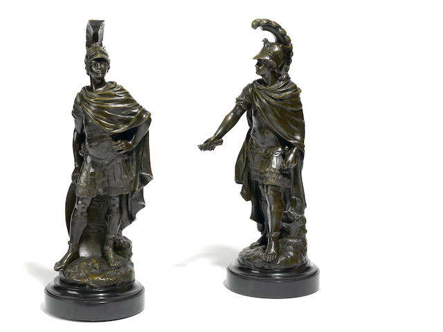 A pair of bronze figures of Roman soldiers