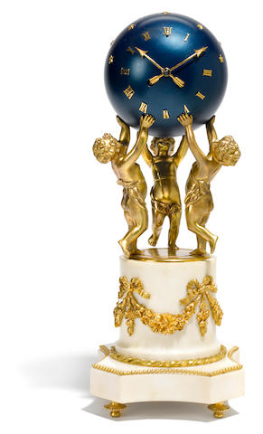 A Louis XV style gilt bronze and marble mantel clock