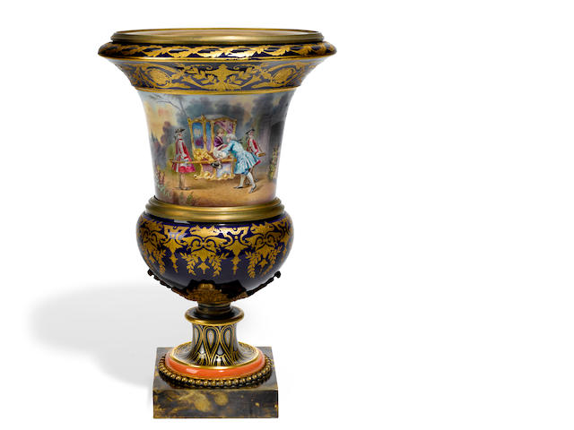 A Sèvres style glazed earthenware gilt bronze mounted urn