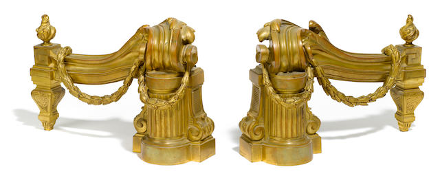A pair of Louis XVI style gilt bronze chenets  Bouhan Frères late 19th century
