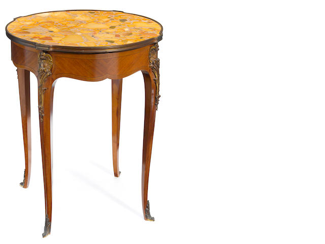 A Louis XV style gilt bronze mounted mahogany table with marble top