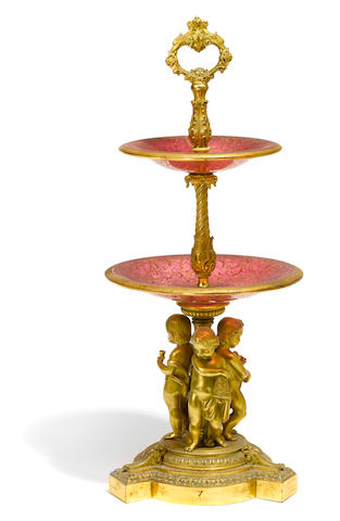 A Napoleon III gilt bronze and gilt heightened cranberry glass surtout de table  third quarter 19th century