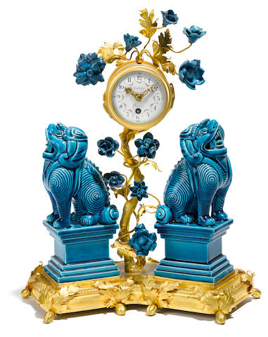 A French gilt bronze mounted and Chinese porcelain mantel timepiece