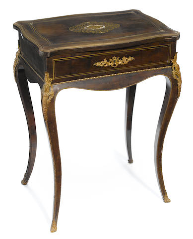 A Louis XV style gilt bronze mounted inlaid mahogany table