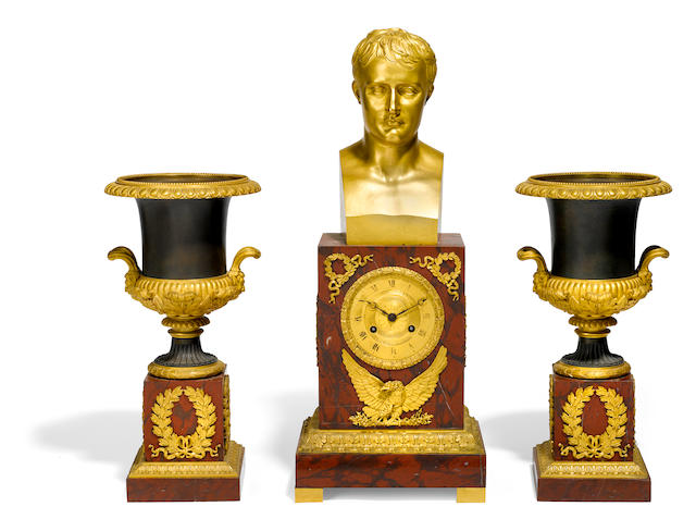 A French gilt bronze and rouge marble mantel clock