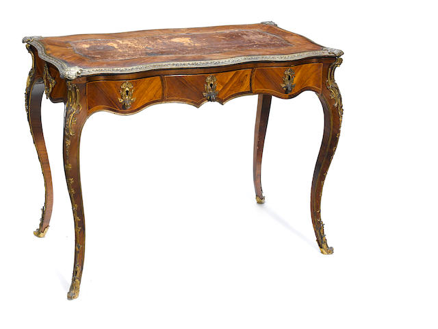A Louis XV style gilt bronze mounted walnut and palisander bureau plat