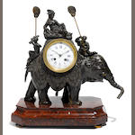 A French patinated bronze and rouge marble elephant mantel clock