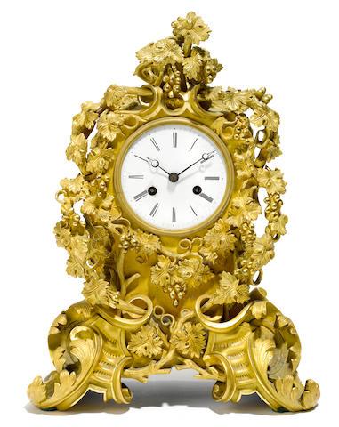 A Louis XV style gilt bronze mantle clock