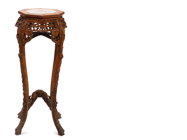 A Chinese carved hardwood and marble pedestal