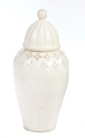 A large carved marble covered jar