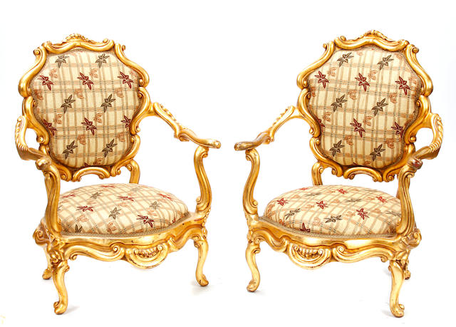 A pair of Louis XV style paint decorated armchairs