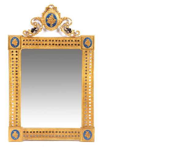 A pair of Louis XVI style gilt bronze mirrors
