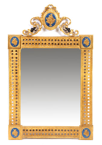 A pair of Louis XVI style gilt bronze mirrors