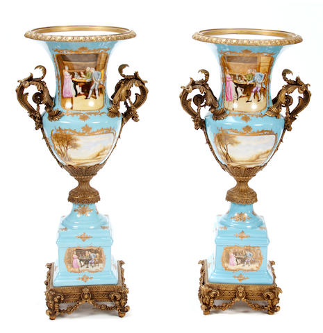 A pair of Continental Rococo style gilt metal mounted porcelain vases