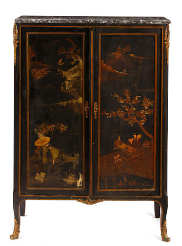 A Rococo style gilt bronze mounted chinoiserie decorated cabinet