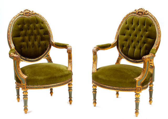 A set of four Louis XVI style parcel gilt paint decorated armchairs
