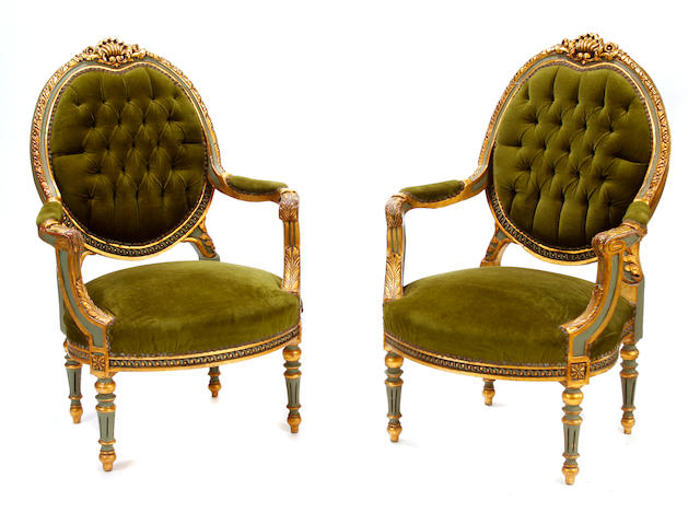 A set of four Louis XVI style parcel gilt paint decorated armchairs