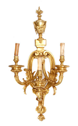 A large pair of Louis XVI style three light gilt bronze bras de lumière