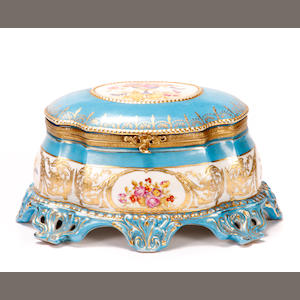 A Louis XV style paint decorated porcelain table casket