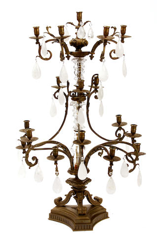 A Louis XVI style bronze glass and rock crystal twelve light candelabra