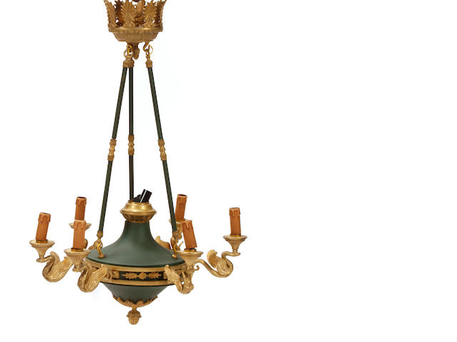 A pair of Empire style gilt bronze and tôle seven light chandliers