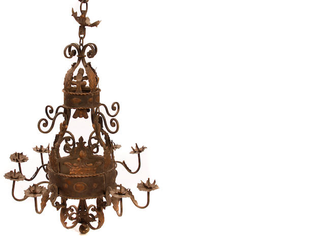 A Renaissance style wrought iron and tôle nine light chandelier
