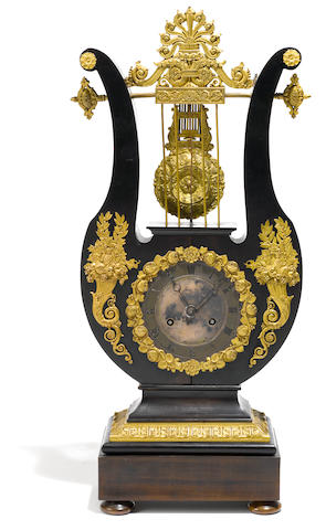 A French gilt bronze mounted ebonized lyre form clock