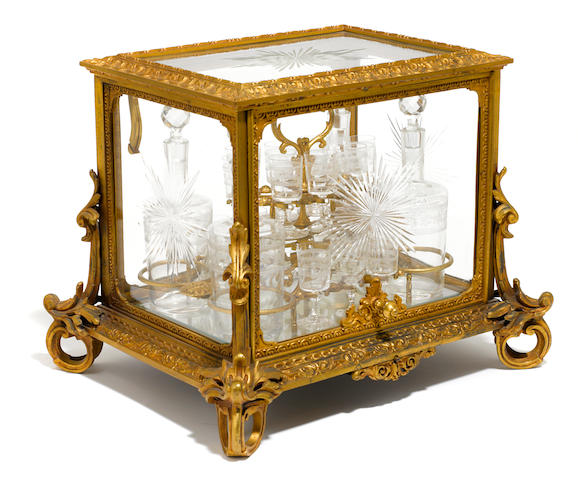 A French gilt bronze and cut glass tantalus