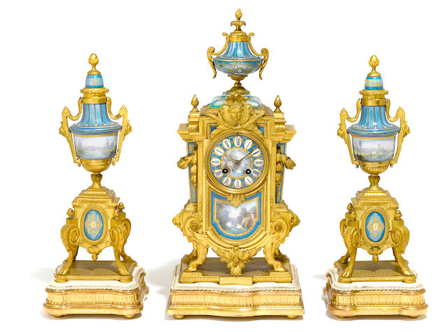 A French gilt bronze and 'jeweled' porcelain clock garniture  early 20th century