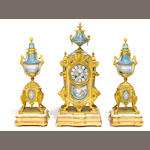 A French gilt bronze and porcelain clock garniture