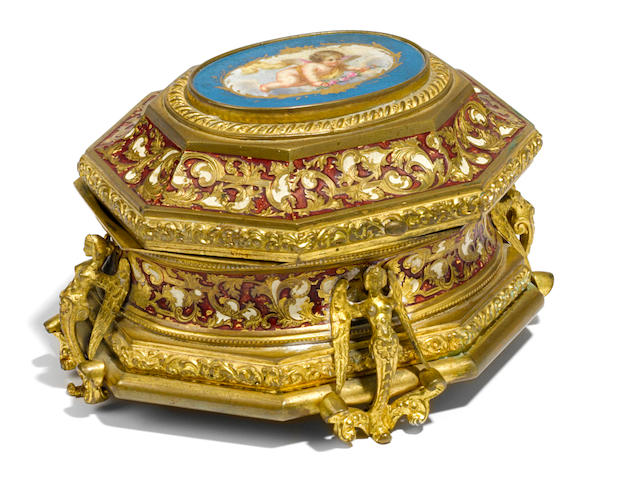 A Continental porcelain inset and enameled gilt bronze table box