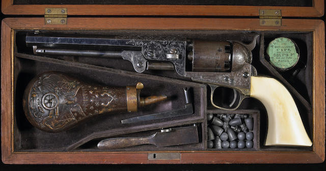 A fine cased Gustave Young engraved Colt Model 1851 Navy revolver