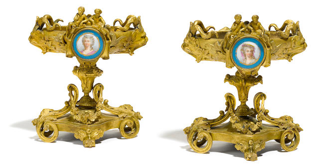 A pair of French gilt bronze and porcelain compotes