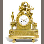 An Empire gilt bronze mantel clock